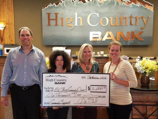 High Country Bank presents a check to member of the BV Strong Dinner planning committee