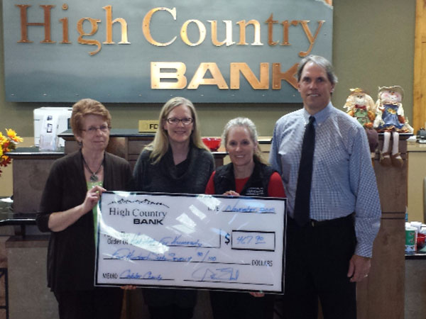High Country Bank employees present a donation to Habitat for Humanity