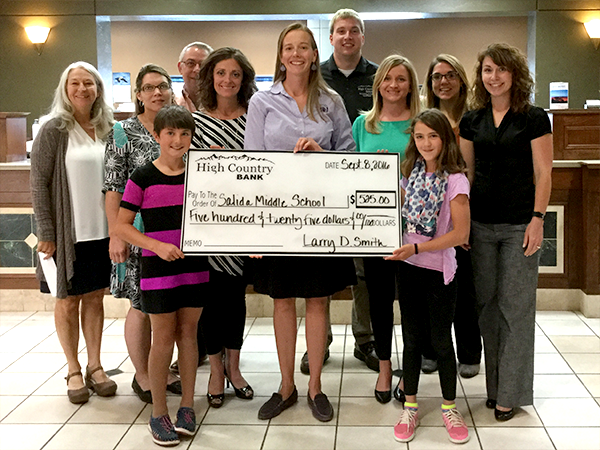 High Country Bank employees present a check to the Salida 5th Graders